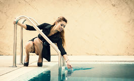 Happy beautiful thai female enjoying near swimming pool Royalty Free Stock Photography