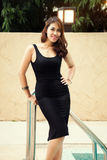 Happy beautiful thai female enjoying near swimming pool Stock Images