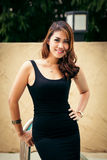Happy beautiful thai female enjoying near swimming pool Royalty Free Stock Image