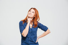 Happy beautiful thoughtful redhead young woman standing and dreaming Royalty Free Stock Images