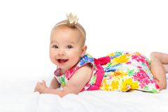 Happy beautiful baby girl with crown on head royalty free stock photos