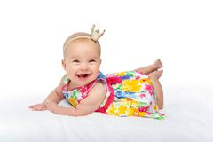 Happy beautiful baby girl with crown on head royalty free stock images
