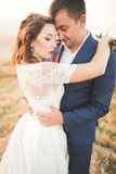 Happy beautiful wedding couple bride and groom at wedding day outdoors on the mountains rock. Happy marriage couple Stock Photo