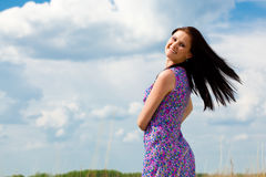 Happy beautiful woman. Portrait over blue skies Royalty Free Stock Image
