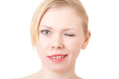 Happy beautiful woman. Touching face and looking at camera winks Stock Photos