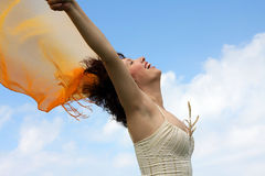 Happy beautiful woman. With open hands against the sky Royalty Free Stock Image