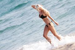 Happy beautiful woman in black bikini Stock Photography