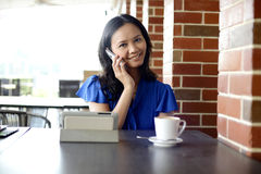 Happy beautiful woman in Cafe Stock Photography