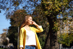 Happy beautiful woman calling by phone Stock Images