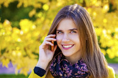 Happy beautiful woman calling by phone Stock Image