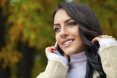 Happy beautiful woman calling by phone Royalty Free Stock Image