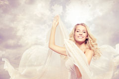Happy beautiful woman carefree dancing with flying fabric. Happy woman, beautiful blonde carefree dancing with flying fabric royalty free stock images