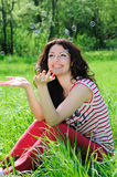 Happy beautiful woman catches soap bubbles stock image