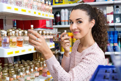Happy beautiful woman choosing fragrance Stock Photography