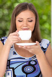 Happy beautiful woman with coffee cup in hands. Royalty Free Stock Photos