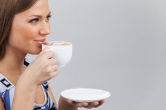 Happy beautiful woman with coffee cup in hands. Stock Photography