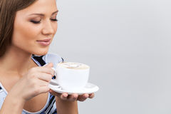 Happy beautiful woman with coffee cup in hands. Royalty Free Stock Images