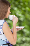 Happy beautiful woman with coffee cup in hands. Stock Image