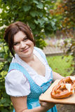 Happy beautiful woman in dirndl dress Royalty Free Stock Photos