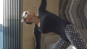 Happy and beautiful woman doing exercise of yoga at home. stock footage