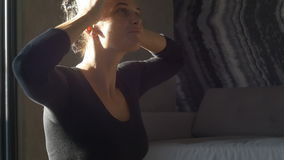 Happy and beautiful woman doing exercise of yoga at home. stock video footage