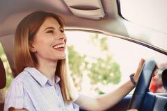 Happy beautiful woman driving car. Happy beautiful woman driving modern car stock photo