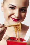 Happy beautiful woman eating chinese food. red lips.smile Stock Photo
