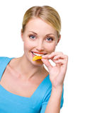 Happy beautiful woman eats the chips Royalty Free Stock Photo
