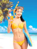 Happy beautiful woman enjoying at beach. Pretty girl with a protective swim mask on the head Royalty Free Stock Photo