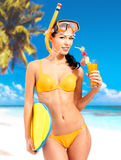 Happy beautiful woman enjoying at beach. Pretty girl with a protective swim mask on the head Royalty Free Stock Photos