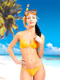 Happy beautiful woman enjoying at beach. Pretty girl with a protective swim mask on the head Stock Images