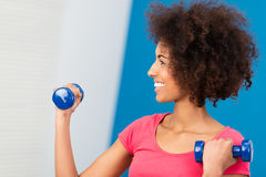 Happy beautiful woman exercising in the gym Stock Images