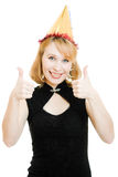 Happy beautiful woman in a festive hat Stock Photos