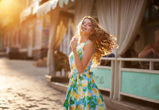 Happy beautiful woman with flattering long hair in the summer st. Reet at the sunset Stock Images