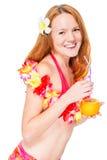 Happy beautiful woman in floral lei and bikini stock photo