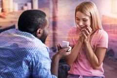 Happy beautiful woman getting a marriage proposal. Romantic moment. Happy beautiful young girl looking at her boyfriend and smiling while getting a marriage Stock Photography