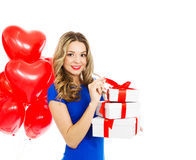 Happy beautiful woman with gift boxes Royalty Free Stock Image