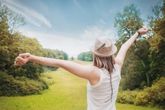 Happy Beautiful woman with hands up in summer. Outdoor Royalty Free Stock Photo