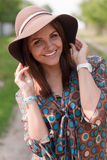 Happy beautiful woman with hat outdoors Stock Images
