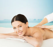Happy beautiful woman having back massage Royalty Free Stock Image