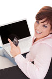 Happy  beautiful woman holding credit card and  laptop Royalty Free Stock Photos