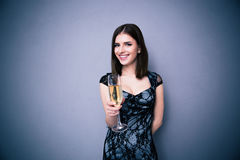 Happy beautiful woman holding glass of champagne Royalty Free Stock Photos