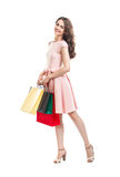 Happy beautiful woman holding many colorful shopping bags isolated on white background stock photography
