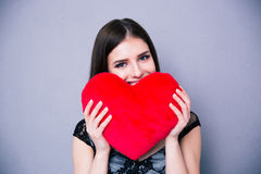 Happy beautiful woman holding red heart Stock Photo