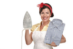 Happy beautiful woman housewife ironing a shirt Stock Images