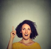 Happy beautiful woman with idea looking up pointing with finger up Stock Photography