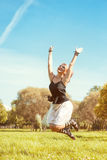 Happy beautiful woman jumping Royalty Free Stock Images