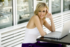 Happy beautiful woman with laptop computer Royalty Free Stock Photo
