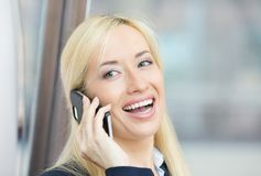 Happy beautiful woman laughing, speaking on cell phone. Closeup portrait, headshot happy beautiful woman laughing, speaking on cell phone, isolated background Stock Photo