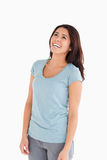 Happy beautiful woman laughing while standing. Against a white background Stock Image